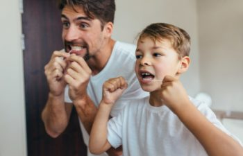 Dad with son flossing