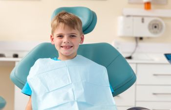 Smiling boy on the dentist chair
